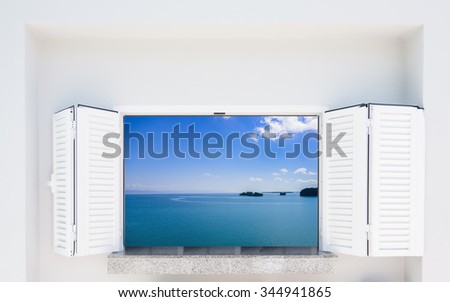 open window with white shutters overlooking the sea - stock photo