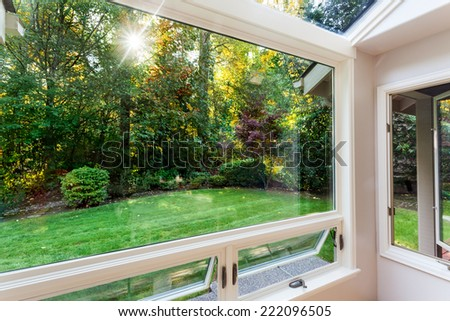 Open windows over the sun in a garden in early fall - stock photo