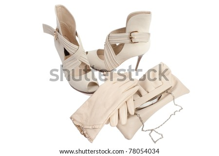open women's shoes beige high-heeled shoes gloves and a handbag - stock photo