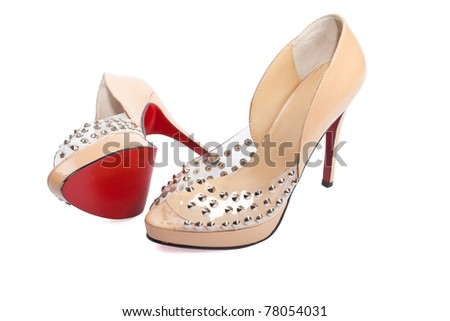 open women's shoes beige high-heeled shoes with red soles - stock photo