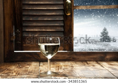 open wooden window and glass of wine  - stock photo
