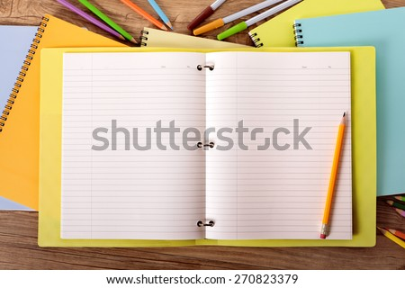 Open writing book on student desk, pencil, copy space - stock photo