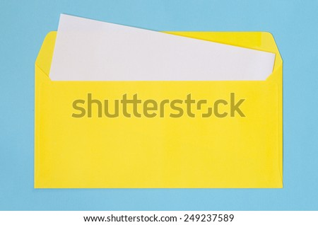 open yellow envelope with  blank paper on blue background - stock photo