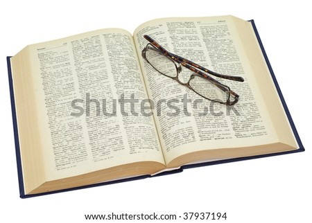 open yellowed old book with glasses, saved with clipping path - stock photo