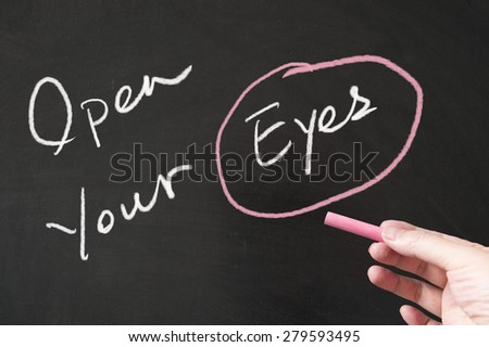 Open your eyes words written on the blackboard using chalk - stock photo