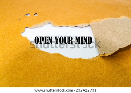 Open Your Mind appearing behind torn brown envelope  - stock photo