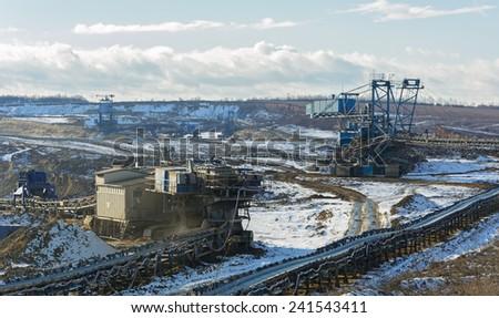 Opencast coal mine winter season - stock photo