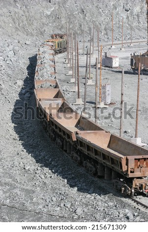 opencast mine excavation and railway - stock photo