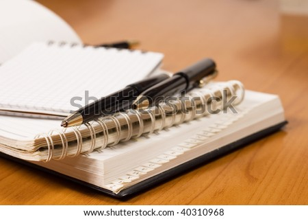 Opened address books, focused on top of pencil - stock photo