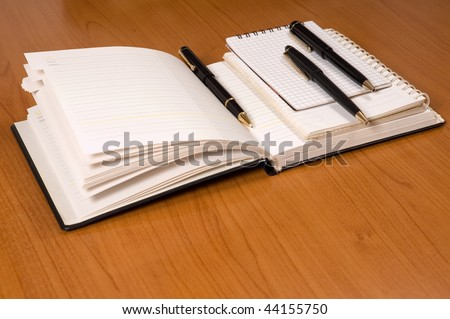Opened address books with pencils - stock photo
