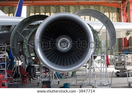opened aircraft engine in the hangar - stock photo