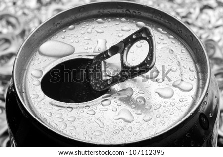 opened aluminum can with water drop - stock photo