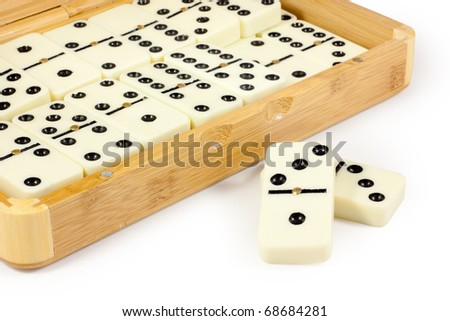 Opened bamboo box with domino. Isolated on white background with clipping path. - stock photo