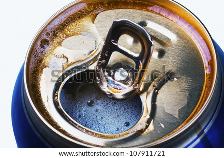 Opened beer can with froth close-up - stock photo
