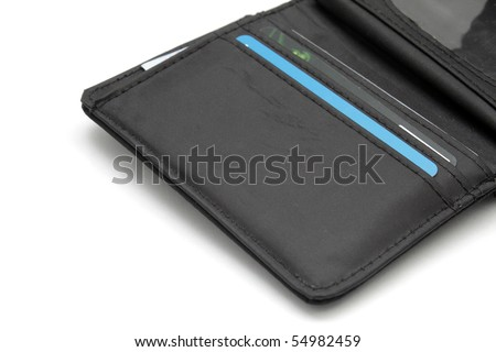Opened black wallet with cards inside on white background