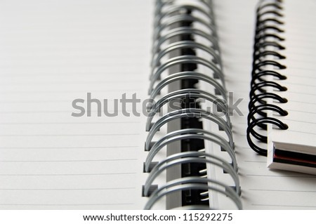 Opened blank coiled note pads