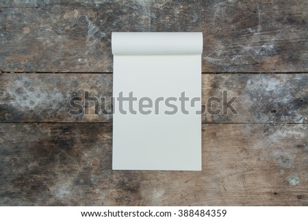 opened blank note books - soft pages texture - on old wood table background - stock photo