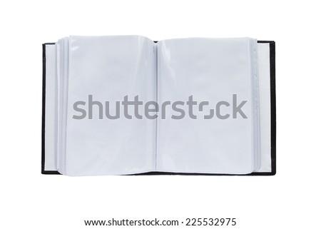 Opened blank photo album on white background - stock photo