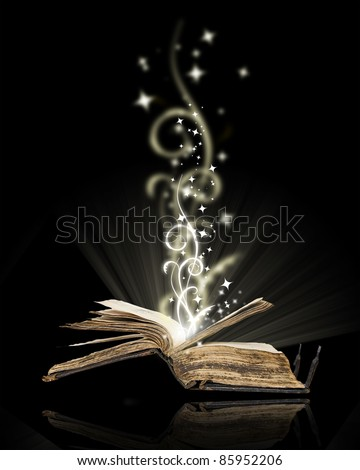 Opened book magic on black - stock photo
