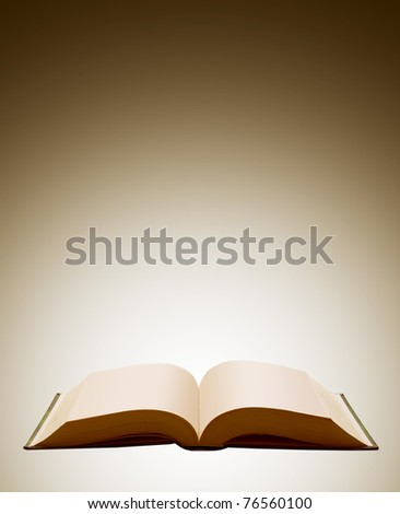 Opened book on a brown background