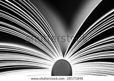 Opened book on black background - stock photo