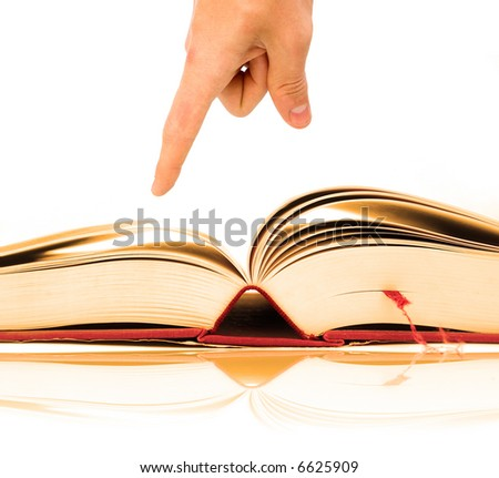 Opened book on bright white background - stock photo