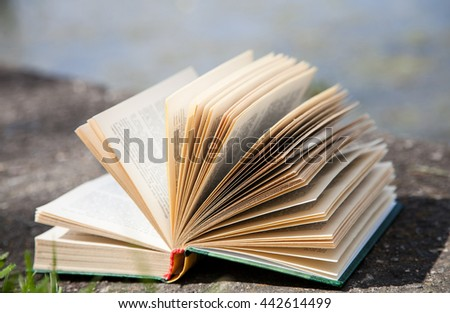 Opened book on concrete background