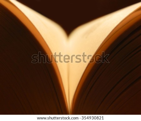 Opened book soft focus  - stock photo