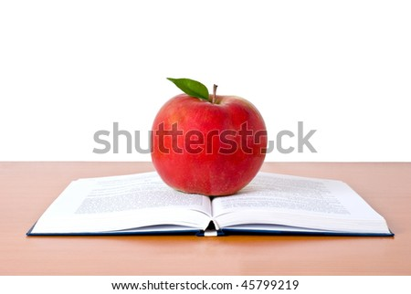 Opened book with red apple - stock photo