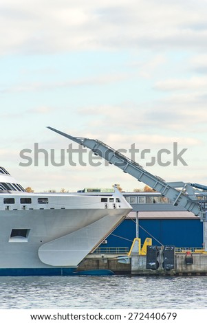 Opened bow visor is ready to take cargo. - stock photo
