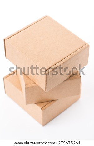 Opened brown cardboard box over the white background, isolated - stock photo