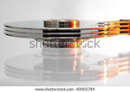 opened computer hard-drive on white background - stock photo