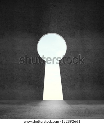 opened concrete wall in form of a keyhole - stock photo