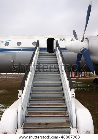 opened door old plane with ramp - stock photo