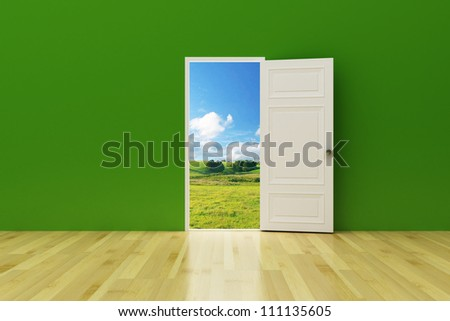 opened door on the green wall to future - stock photo