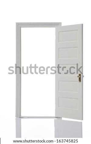 Opened door on white background - stock photo
