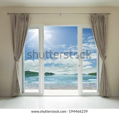 Opened door, sea view background - stock photo