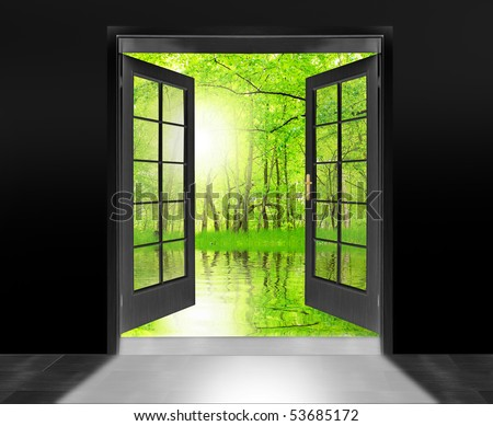 Opened door to beautiful sunrise in imaginary rural landscape - conceptual image - environmental business metaphor. - stock photo