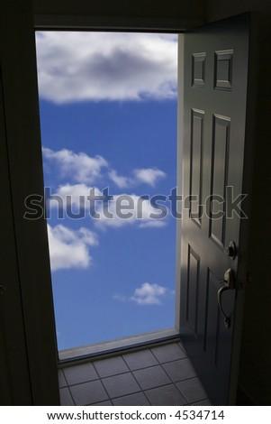 opened door to clouds - stock photo