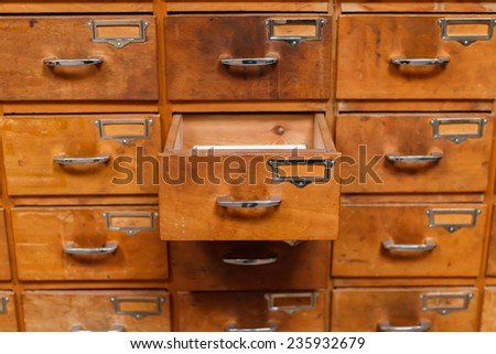 Opened drawer in vintage storage module - stock photo
