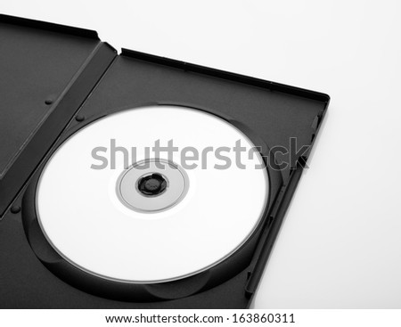 opened dvd box with empty disc over white background
