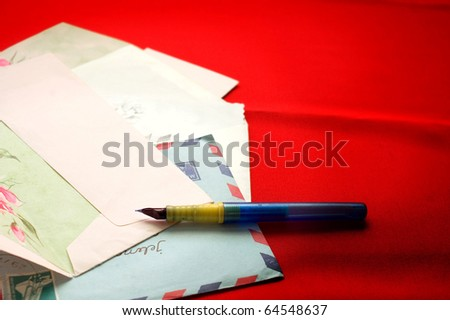 Opened envelope, air mail and pen - stock photo