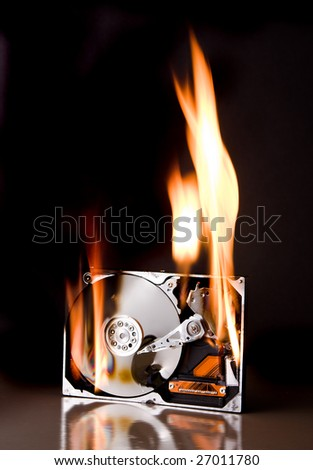 Opened external hard disk on fire - brand names have been removed - stock photo