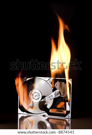 Opened external hard drive on fire - brand names have been removed - stock photo