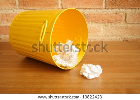 Opened garbage bin with some waste around - stock photo