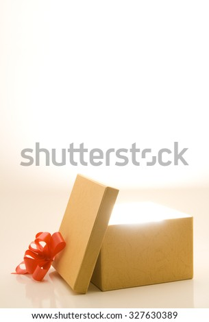 Opened gift box with light and room for text - stock photo
