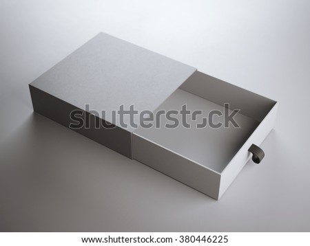 Opened gray box with leather handle