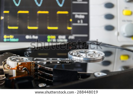 opened HDD in a test laboratory ready for data recovery or repair - stock photo
