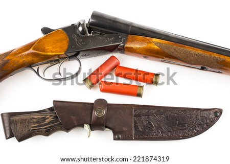 Opened hunting rifle with cartridges and knife in case isolated on white  - stock photo