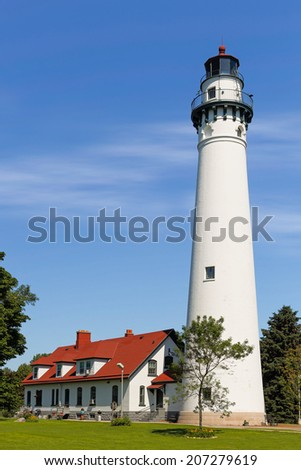 Opened in 1880, Wisconsin's picturesque Wind Point Lighthouse marks the north end of harbor in Racine. - stock photo